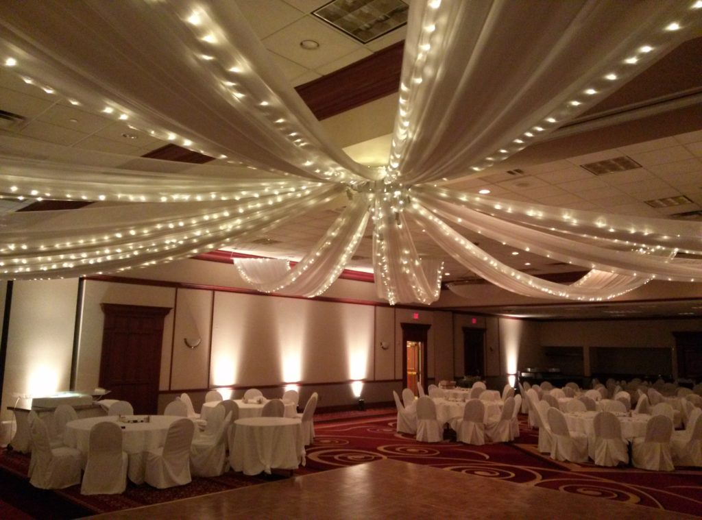 9-spoke ceiling drape with twinkle lights and uplights